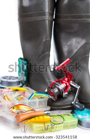 fishing tackles and rubber boots on white background. for design advertising or publication