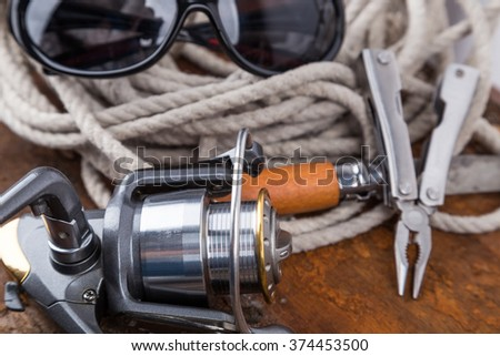 fishing tackles for anglers - swimmers, plummes and tools on wooden background