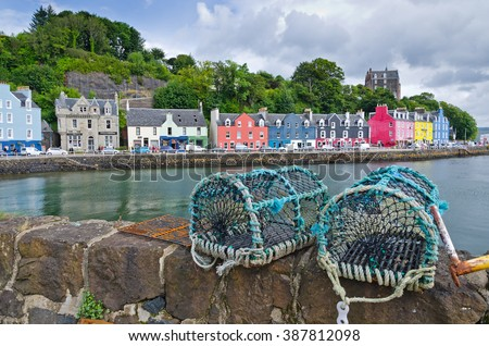 Fishing traps on a wall in summertime in the town of Tobermory on the isle of Mull in the inner Hebrides. - stock photo