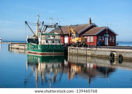 Fishing trawler docking in a Danish commercial harbor - stock photo