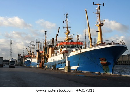 Fishing trawlers at the quay in the harbor of Scheveningen