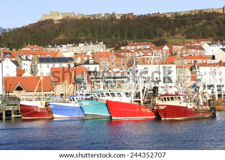 Fishing trawlers berthed in the harbour at Scarborough, North Yorkshire, England