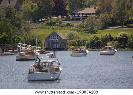 Fishing trawlers in quiet Maine harbor - all registration markings and names removed  - stock photo