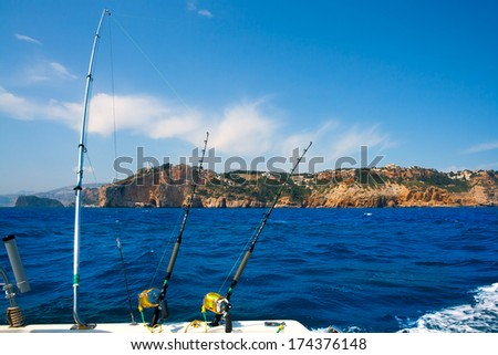 Fishing trolling boat rods in Mediterranean Cabo Nao Cape at Alicante Spain - stock photo