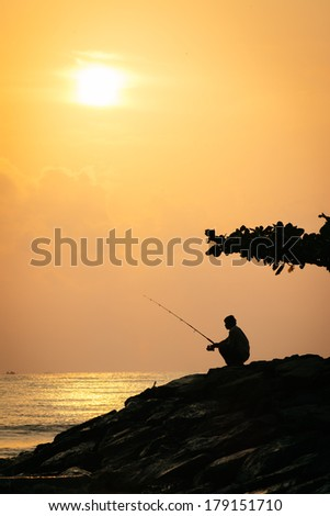 Fishing under the Sun. Fishing next to the sea.