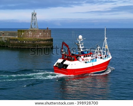 Fishing Vessel Departing, fishing boat underway to fishing grounds. - stock photo