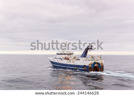 Fishing vessel for fishing in the sea. A Sunny day. Calm weather. - stock photo