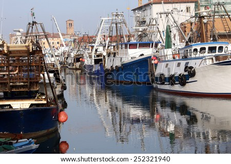 Fishing vessels in sea haven moored in Italy - stock photo