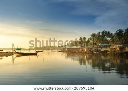 Fishing Village and sunrise - stock photo