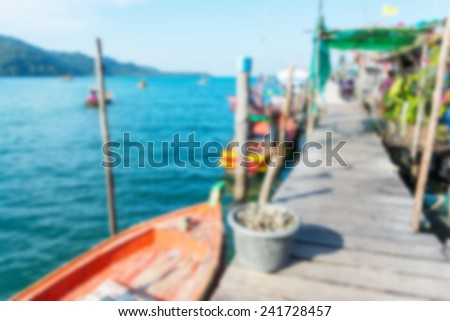 Fishing village at the sea. Defocused blur background.