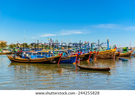 Fishing village with a lot of colorful, traditional fishing boats, Mui Ne, Phan Thiet, Vietnam, Southeast Asia  - stock photo