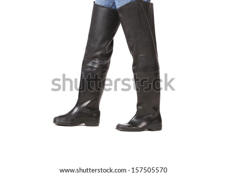 Fishing wellingtons on man. Isolated on a white background.