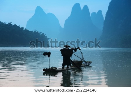fishing with cormorants birds in Yangshuo, Guangxi region, traditional fishing use trained cormorants to fish, China - stock photo