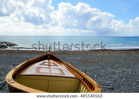 fishing wooden boat moored on the beach