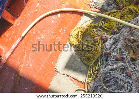 Fishnets on fish boat. Greece, Athens - stock photo