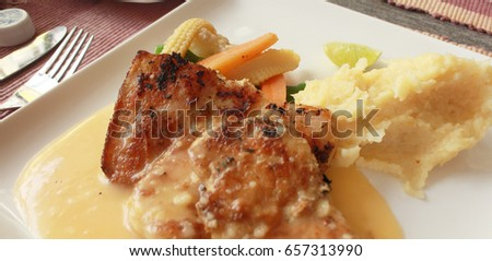 Fishsteak grill with mashed potato.