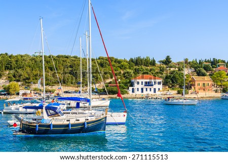 FISKARDO PORT, KEFALONIA ISLAND - SEP 19, 2014: view of colorful houses and yacht boats in Fiskardo village. Greek islands are popular holiday destination in Europe.