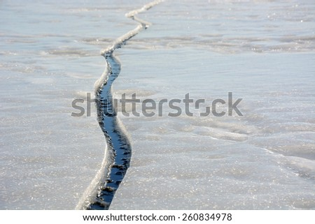 Fissure on the ice - stock photo