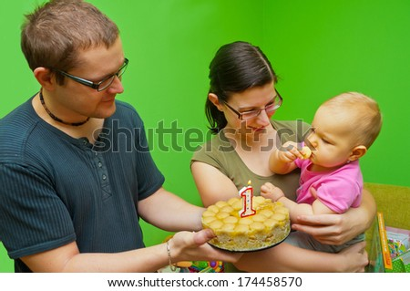 fist birthday with her parents