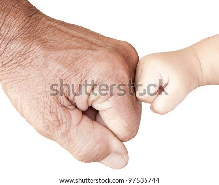 Fist bump with hard and soft hands - stock photo