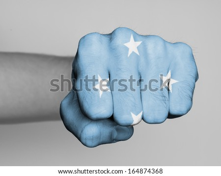 Fist of a man punching, flag of Micronesia