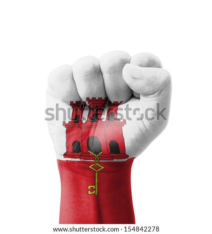 Fist of Gibraltar flag painted, multi purpose concept - isolated on white background - stock photo
