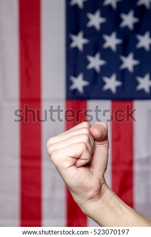 fist on a background of the American flag
