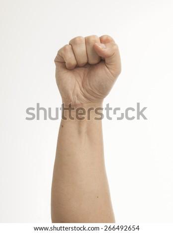 Fist on white - stock photo