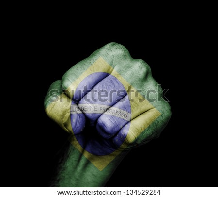 fist painted in colors of brazil flag - stock photo