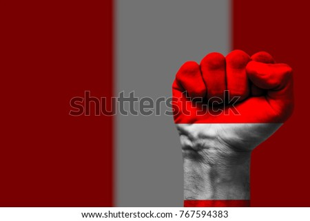 Fist painted in colors of Peru flag, fist flag, country of Peru