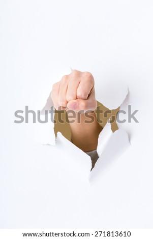 Fist punching paper - stock photo