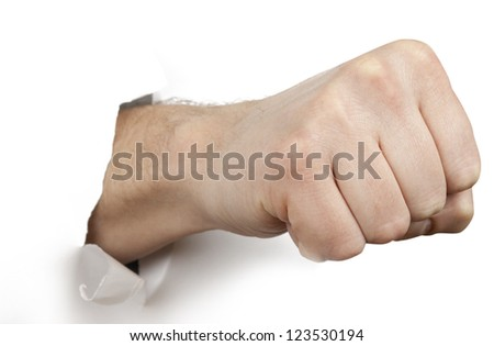 Fist punching paper isolated on white background - stock photo