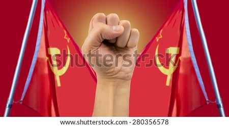 fist with communist USSR flag - stock photo