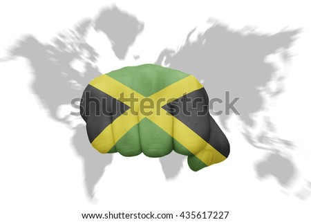fist with the national flag of jamaica on a world map background