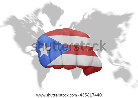 fist with the national flag of puerto rico on a world map background - stock photo