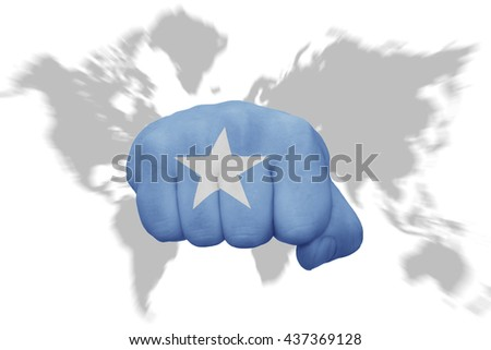 fist with the national flag of somalia on a world map background