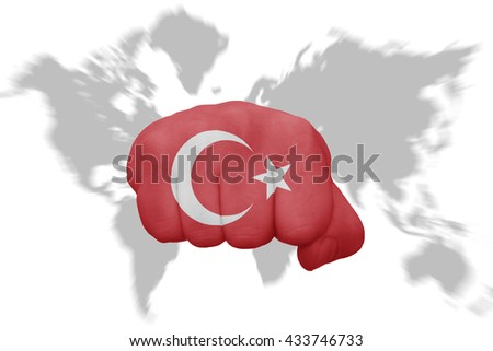 fist with the national flag of turkey on a world map background