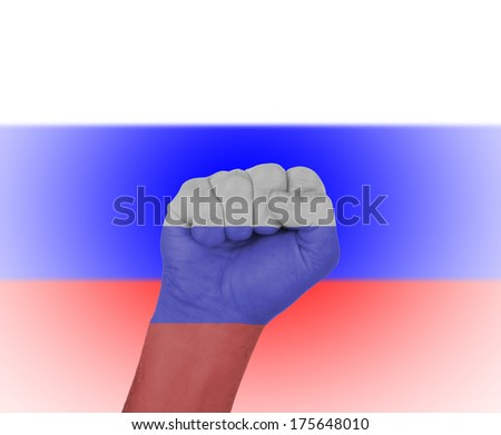 Fist wrapped in the flag of Russia and flag in the background - stock photo