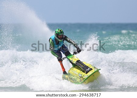 Fistral Beach, Newquay, Cornwall, UK. 6th June, 2015. Professional jet ski riders compete at the IFWA World Tour Jet Ski Championship. A disabled contestant performs tricks for judges in the waves.