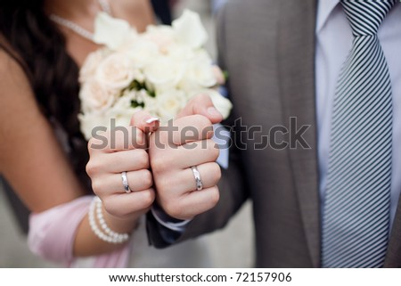 fists of bride and groom - stock photo