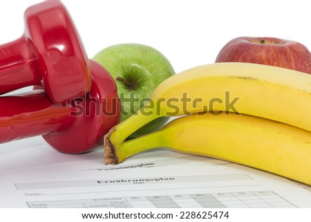 fit and healthy with workout plan, dumbbells and apples - stock photo