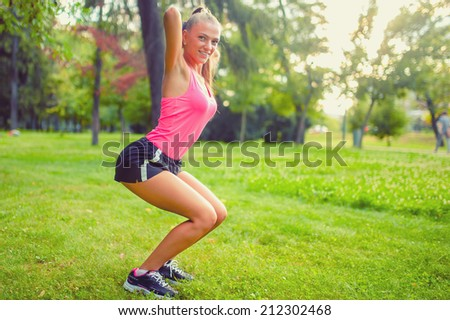 fit and muscular woman in park, doing squats and running at sunset. fitness training and workout - stock photo