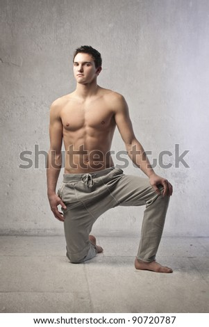 Fit bare-chested handsome man - stock photo