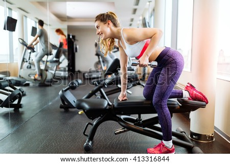 Fit beautiful  woman working out in gym - stock photo