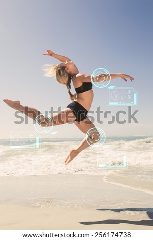 Fit blonde jumping gracefully on the beach against fitness interface - stock photo