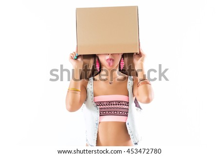 Fit blonde woman standing, holding cardboard box over head, hiding face, posing, having fun