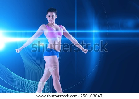 Fit brunette posing and looking at camera against futuristic glowing black background