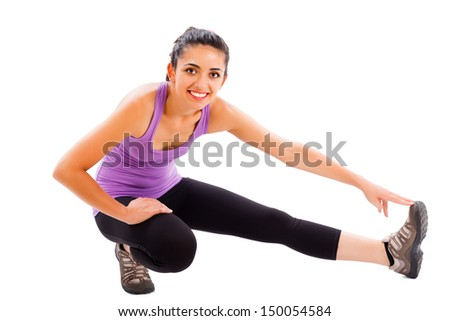 Fit brunette woman showing how to keep fit doing warming up exercises.