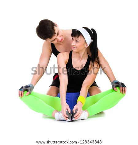 Fit couple exercising against isolated white background - stock photo
