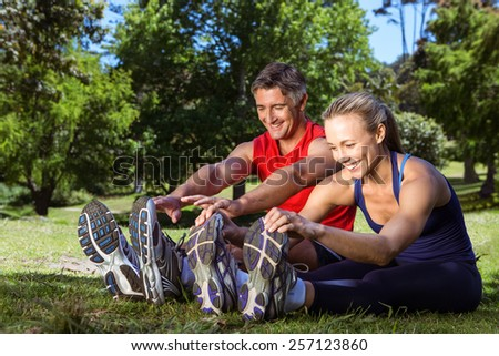 Fit couple in the park on a sunny day - stock photo